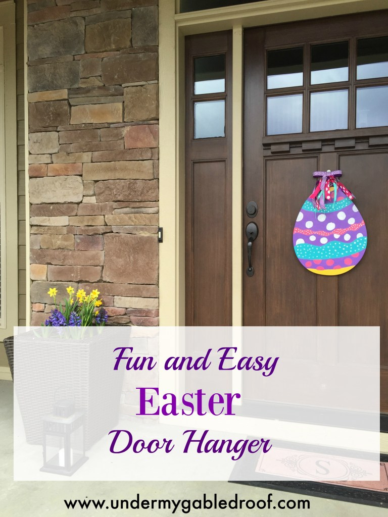 DIY Easter Egg Wooden Door Hanger that is perfect for spring! Cheap and easy to personalize and a great alternative to a wreath! Add ribbon for more pizazz!