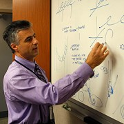 UNMC renal specialist Marius Florescu, M.D., draws up his ideas for a better AV fistula and improved hemodialysis.