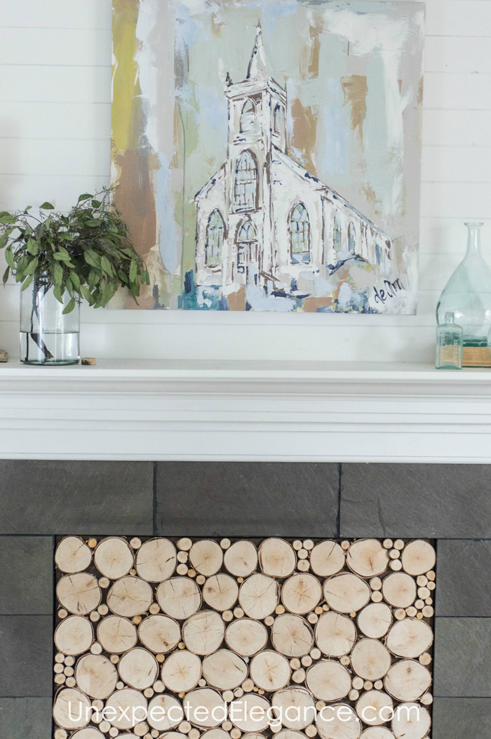 Want to add interest to your fireplace? Get a quick and easy tutorial for creating a faux woodstack insert! It's also a great way to keep out drafts.