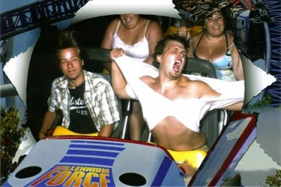 Guy Ripping Shirt Off On Roller Coaster