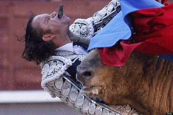 Bull fighter gets bull horn right through the chin throat and mouth