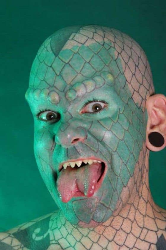Eric Spraque is the lizard man with split tongue modification