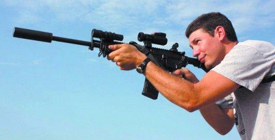 Dustin Ellermann using a sniper rifle