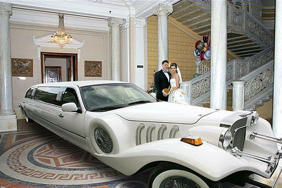 car in mansion