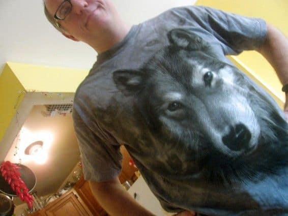 man wearing wolf shirt