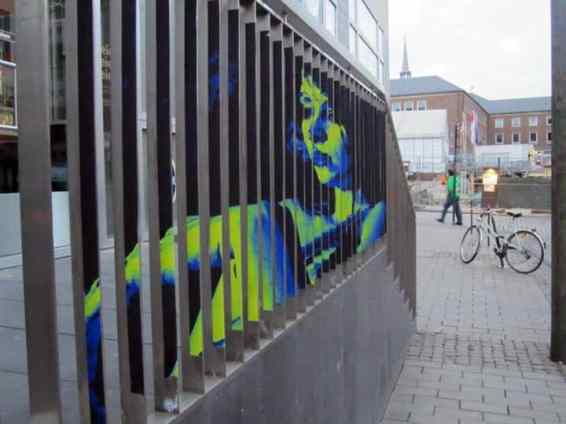 neon woman on railing
