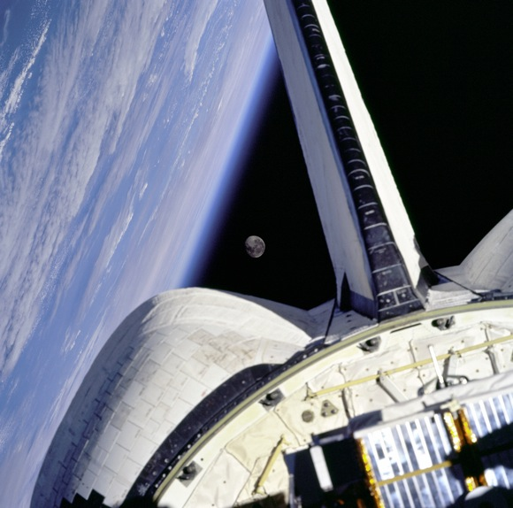 The Earth and Moon, seen from the shuttle Discovery. Image credit: NASA