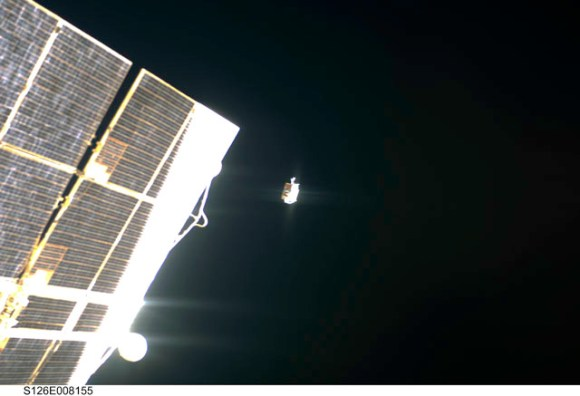 Lost tool bag floats away from the ISS.  Credit: NASA