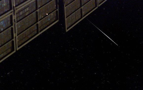 An iridium satellite flare as seen from the ISS.  Credit: Don Pettit, NASA