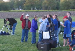Teaching hands-on astronomy.  Credit: N. Atkinson