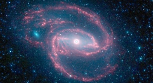 "The ""eye"" at the center of the galaxy is actually a monstrous black hole surrounded by a ring of stars. Credit: NASA/JPL"