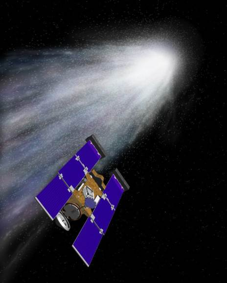 Artists concept of the stardust spacecraft flying throug the gas and dust from comet Wild 2. Credit: NASA/JPL