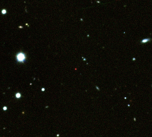 This image shows the afterglow of GRB 090423 (red source in the centre) and was created from images taken in the z, Y and J filters at Gemini-South and VLT (credit: A. J. Levan).
