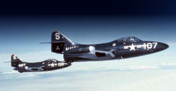Two F9F-2 Panthers over Korea, with Armstrong piloting S-116 (left). Credit: U.S. Navy National Museum of Naval Aviation