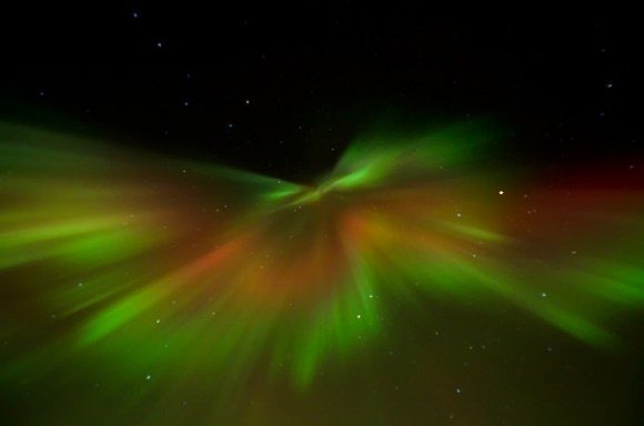 This photo was taken on January 22, 2012 in Fairbanks North Star Borough County, Alaska, US, using a Nikon D5000. The explodey look is due to perspective from looking right up the magnetic field lines. The aurora in the middle of the explosion is pointing straight down at the camera. Credit: Jason Ahrns