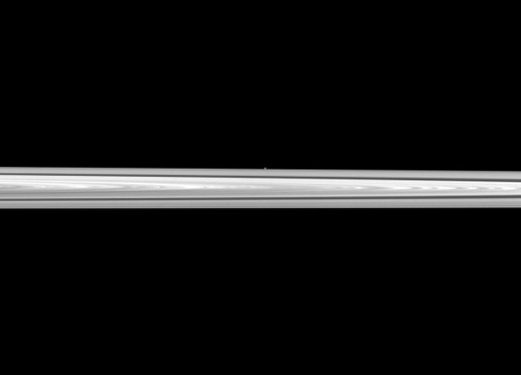 Saturn's tiny moon Atlas shines with the rings