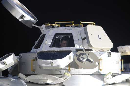 From the outside, the cupola looks like an extraterrestrial spacecraft. That's Douglas Wheelock (Expedition 25) inside the window. Credit: NASA