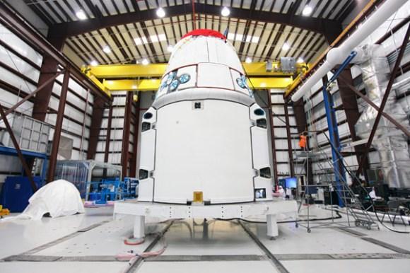 Dragon in the processing hangar at Cape Canaveral. (Credit: NASA/Kim Shiflett).