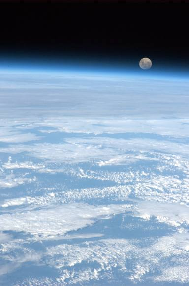 'The full moon rises over the only planet we have ever called home,' Tweeted astronaut Chris Hadfield.