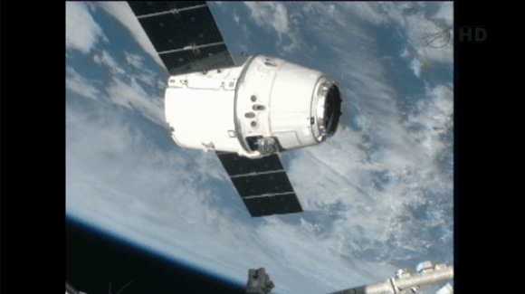 "SpaceX Dragon holding at 10m capture point. ISS crew standing by for ""go"" to perform grapple. Credit: NASA"