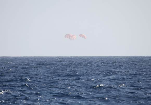 This picture captures the Dragon just as it hits the water in the Pacific Ocean. Credit: SpaceX.