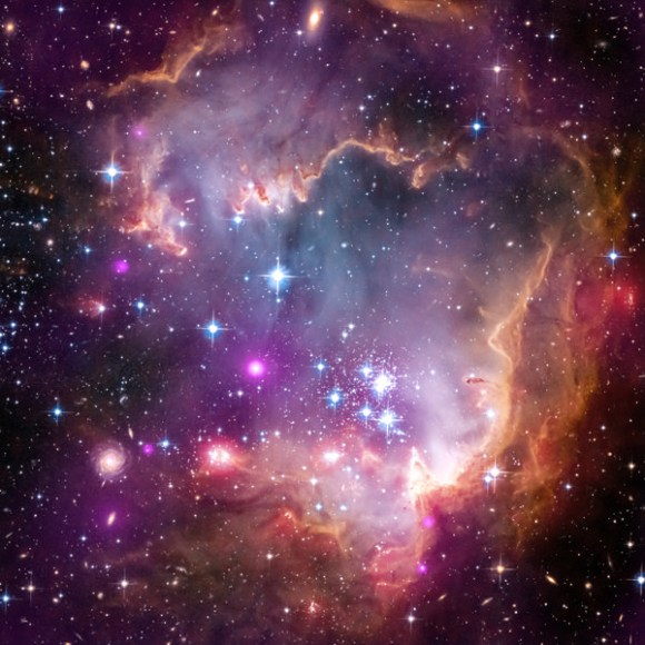 A part of the Small Magellanic Cloud galaxy is dazzling in this new view from NASA's Great Observatories. The Small Magellanic Cloud, or SMC, is a small galaxy about 200,000 light-years way that orbits our own Milky Way spiral galaxy. Credit: NASA.
