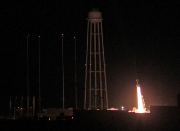 Ignition of NASA Black Brant XII suborbital rocket following night time launch at 11:05 p.m. EDT on June 5, 2013 from the NASA Wallops Flight Facility at the eastern Virginia shoreline. The launch pad sits in front of the Antares rocket Launch Complex 0A dominated by the huge water tower.  The rocket carried the CIBER astronomy payload to an altitude of approximately 358 miles above the Atlantic Ocean to study when the first stars and galaxies formed in the universe and how brightly they burned their nuclear fuel.  Credit: Ken Kremer- kenkremer.com