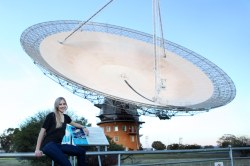 Jacinta Delhaize with CSIRO's Parkes Radio Telescope during one of her data collecting trips. Credit: Anita Redfern Photography.