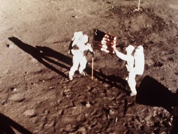 Neil Armstrong and Buzz Aldrin plant the US flag on the Lunar Surface during 1st human moonwalk in history 45 years ago on July 20, 1969 during Apollo 1l mission. Credit: NASA
