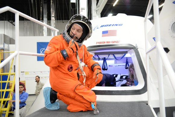 NASA astronaut Randy Bresnik prepares to enter the CST-100 spacecraft, which was built inside The Boeing Company's Houston Product Support Center. Credit:  NASA/Robert Markowitz