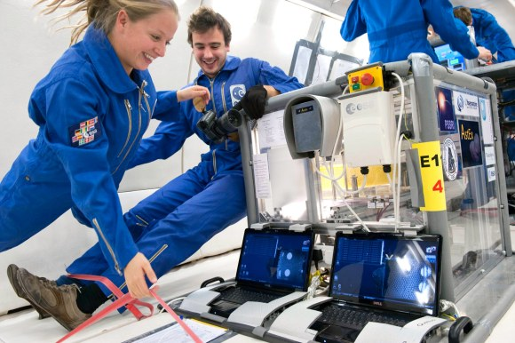 Naomi Murdoch and Thomas-Louis de Lophem in zero gravity alongside the AstEx experiment. Credit: A. Le Floc'h, ESA