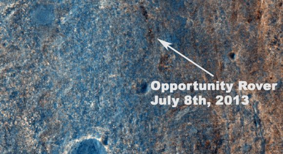 "This image taken by the High Resolution Imaging Science Experiment (HiRISE) camera on NASA's Mars Reconnaissance Orbiter on July 8, 2013, captures Opportunity traversing south (at the end of the white arrow) to new science targets and a winter haven at ""Solander Point,"" another portion of the Endeavour rim. The relatively level ground between Cape York and Solander Point is called ""Botany Bay."" The image was taken 10 years after Opportunity was launched from Florida on July 7, 2013, EDT and PDT (July 8, Universal Time). Image credit: NASA/JPL-Caltech/Univ. of Arizona."