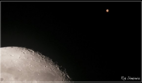 Mars as seen during a close conjunction with the Moon on July 17th, 2003. Mars was 20 arc seconds in size at the time leading up to the August 2003 opposition.