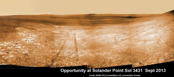 Opportunity starts scaling Solander Point - her1st mountain climbing goal. See the tilted terrain and rover tracks in this mosaic view from Solander Point peering across the vast expanse of huge Endeavour Crater.  Opportunity will ascend the mountain looking for clues indicative of a Martian habitable environment.  This navcam camera mosaic was assembled from raw images taken on Sol 3431 (Sept.18, 2013).  Credit: NASA/JPL/Cornell/Marco Di Lorenzo/Ken Kremer (kenkremer.com). See the complete panoramic view below