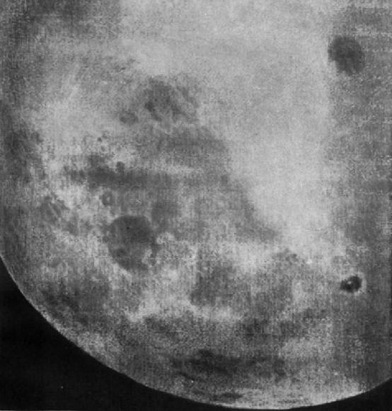 Telephoto image of Mare Moscoviense is at upper right with Tsiolkovsky and its bright central peak at lower right. You can start to see vague outlines of many more craters in this view. Click for more historic photos. Credit: Roscosmos
