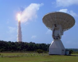 A 50-foot (15-meter) tracking dish at the European Space Agency's tracking station at Kourou, French Guiana. In the background is the successful Herschel and Planck launch of May 14, 2009. Credit: ESA/A. Chance