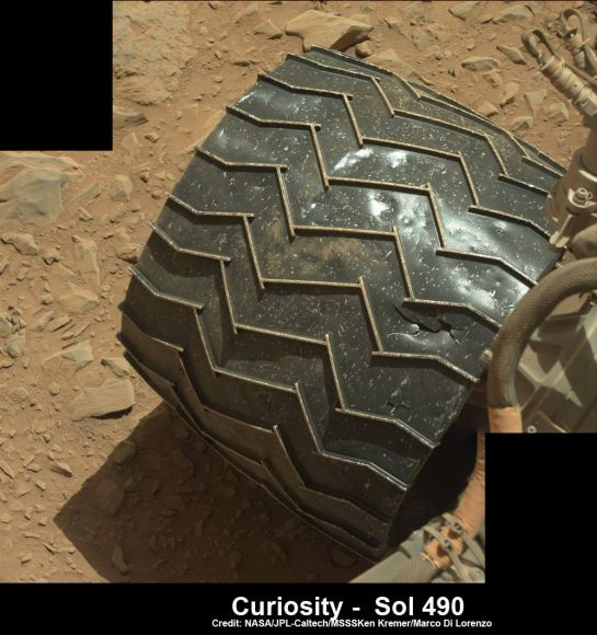Up close view of hole in one of rover Curiosity's six wheels caused by recent driving over rough Martian rocks. Mosaic assembled from Mastcam raw images taken on Dec. 22, 2013 (Sol 490) Credit: NASA/JPL/MSSS/Ken Kremer -kenkremer.com/Marco Di Lorenzo