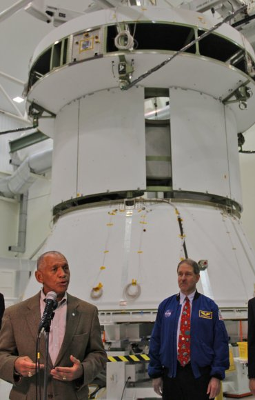 NASA Administrator Charles Bolden and science chief Astronaut John Grunsfeld discusses NASA's human spaceflight initiatives backdropped by the service module for the Orion crew capsule being assembled at the Kennedy Space Center.  Credit: Ken Kremer/kenkremer.com