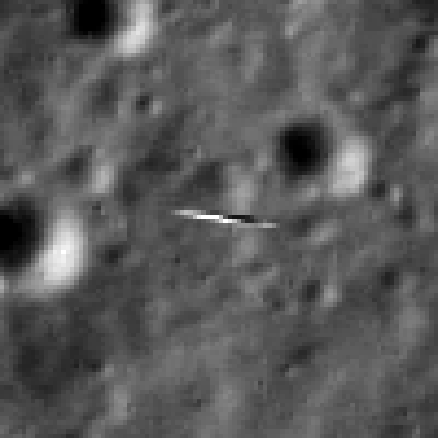 This subsection of the LRO image, expanded four times, shows the smeared view of LADEE against the lunar background..   LADEE is about 2 meters in the long direction. Lunar scene about 81 meter wide.  Credit:  NASA/Goddard/Arizona State University