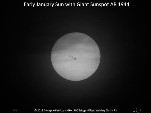 AR144 as seen on January 7, 2014. At the bottom are size comparisons to Earth and Jupiter. Credit and copyright: Giuseppe Petricca.