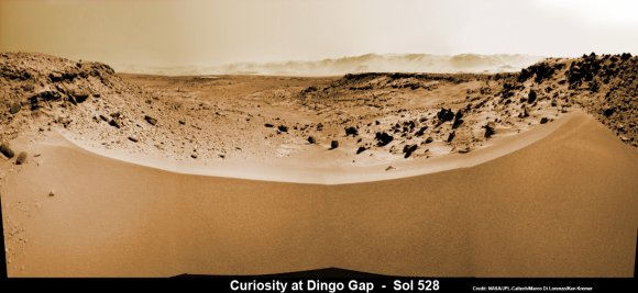 Curiosity's View Past Tall Dune at edge of 'Dingo Gap'  This photomosaic from Curiosity's Navigation Camera (Navcam) taken at the edge of the entrance to the Dingo Gap shows a 3 foot (1 meter) tall dune and valley terrain beyond to the west, all dramatically back dropped by eroded rim of Gale Crater. View from the rover's current position on Sol 528 (Jan. 30, 2014). The rover team may decide soon whether Curiosity will bridge the dune gap as a smoother path to next science destination. Credit: NASA/JPL-Caltech/Marco Di Lorenzo/Ken Kremer- kenkremer.com