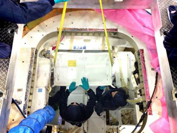 Engineers pack Dragon with cargo, including support for more than 150 science investigations on the ISS. Credit: SpaceX