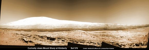 Martian landscape with rows of curved rock outcrops in the foreground and spectacular Mount Sharp on the horizon. NASA's Curiosity Mars rover pulled into Kimberly waypoint dominated by layered rock outcrops as likely drilling site.  This colorized navcam camera photomosaic was assembled from imagery taken on Sol 576 (Mar. 20, 2014).  Credit: NASA/JPL-Caltech/Marco Di Lorenzo/Ken Kremer-kenkremer.com