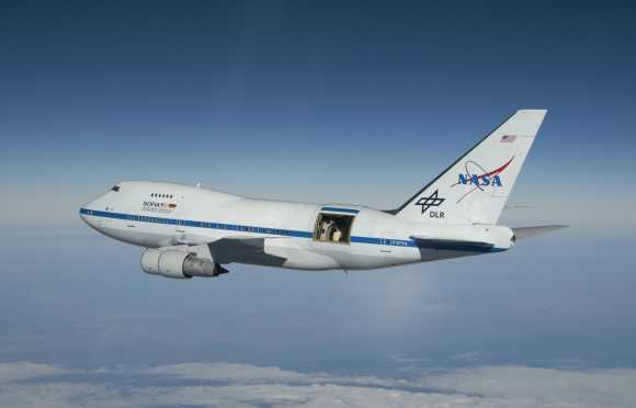 NASA's Stratospheric Observatory for Infrared Astronomy 747SP aircraft flies over Southern California's high desert during a test flight in 2010. Credit: NASA/Jim Ross