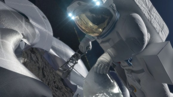An astronaut retrieves a sample from an asteroid in this artist's conception. Credit: NASA