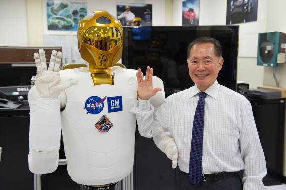"A ground version of NASA's Robonaut 2 (left) flashes a Star Trek Vulcan salutation along with George Takei, a star of the original series, in 2012. ""It was a keen demonstration of Robonaut 2's manual dexterity. The gesture is difficult for many humans to make,"" Takei wrote on Facebook. Credit: NASA/James Blair"