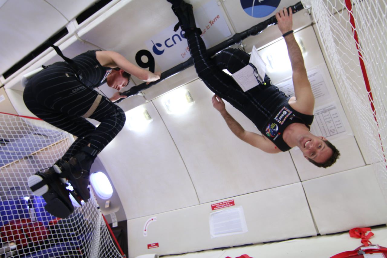 """European Space Agency astronaut Thomas Pesquet (upside-down) testing out the """"skinsuit"""" during a parabolic flight to simulate microgravity in March 2014. Credit: CNES/Novespace"""