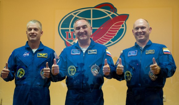 The Expedition 39/40 crew gives a thumbs-up during quarantine prior to their March 25, 2014 launch from Kazakhstan. From left: Steve Swanson (NASA), Alexander Skvortsov (Roscosmos) and Oleg Artemyev (Roscosmos). Credit: NASA