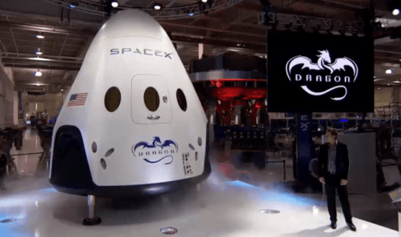 Meet Dragon V2 - SpaceX CEO Elon pulls the curtain off manned Dragon V2 on May 29, 2014 for worldwide unveiling of SpaceX's new astronaut transporter for NASA. Credit: SpaceX
