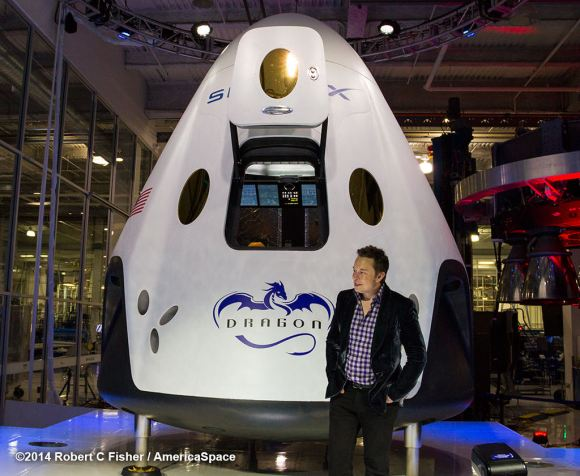 SpaceX CEO Elon Musk unveils SpaceX Dragon V2 next generation astronaut spacecraft on May 29, 2014.  Credit:  Robert Fisher/America Space
